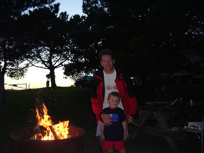 Pat and Christopher getting the campfire going while camping at El Capitan State Beach.