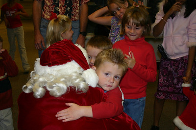 Christopher giving Santa a big hug at the NFESC Christmas Party.