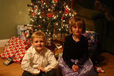 Christopher and Sydney on Christmas Eve getting ready to open some presents.