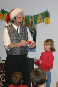 Sydney is the magician's helper during the NFESC Christmas Party.