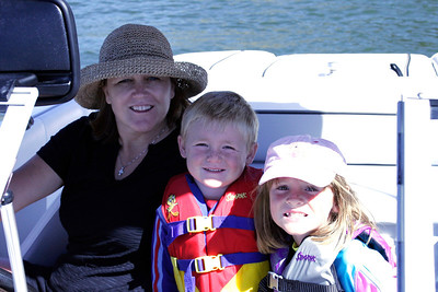 Aunt Betsy is given Christopher and Sydney a ride on Lake Nacimiento in her new boat.