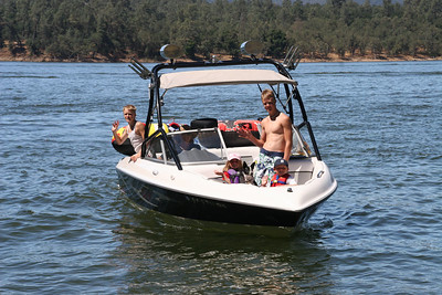 Betsy taking the kids out for a ride on Lake Nacimiento in their new boat.