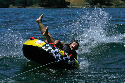 Amy about to fall off her tube on Lake Nacimiento.
