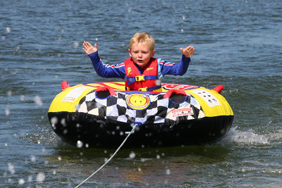 Christopher is getting a little more confident as he lets go of his tube while tubing on Lake Nacimiento.
