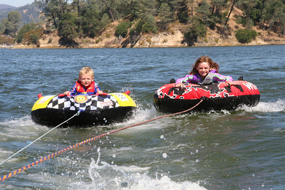 Christopher and Sydney riding tubes all by themselves on Lake Nacimiento.