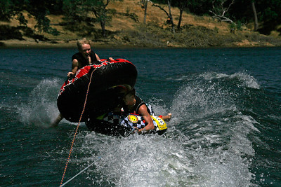 Nathan hopped the boat's wake to pounce on Grady while tubing on Lake Nacimiento.