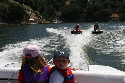 Sydney and Christopher watching their cousins, Nathan and Grady, tubing on Lake Nacimiento.
