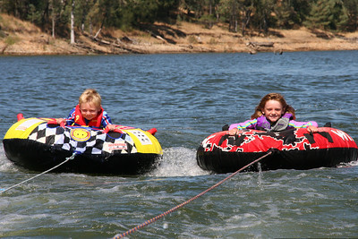 Christopher & Sydney tubing all by themselves on Lake Nacimiento. Aunt Betsy is taking it slow so they can get used to it.