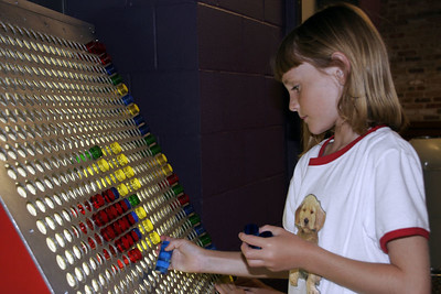 Sydney playing with the giant lite-brite at the Austin Children's Museum.