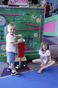 Christopher and Sydney had a lot of fun at the Austin Children's Museum. The main exhibit put golf balls in motion through a variety of devices.
