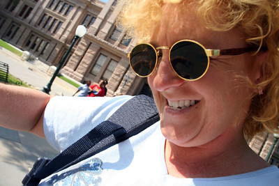Kathy leaving the Texas Capitol trying to fight off a paparazzo who was insisting on getting her picture.