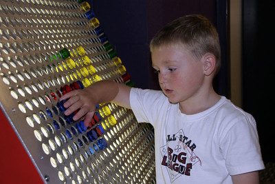 Christopher playing with the giant lite-brite at the Austin Children's Museum.