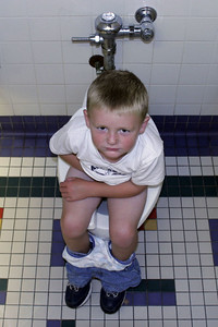 Christopher wasn't too pleased with Dad taking a picture of him on the toilet at the Austin Children's Museum.