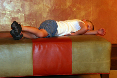 Christopher is worn out from walking around Austin and needed a break in the hotel lobby before heading up to the room.