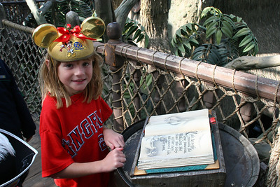 Sydney reading a book inside Tarzan's Treehouse.