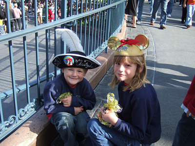 Christopher and Sydney taking a break for a piece of candy while Pat runs off to get us a Fast Pass for another ride.