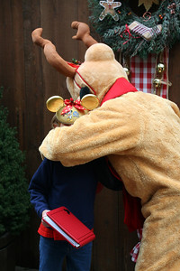 Sydney getting a big hug from Pluto.