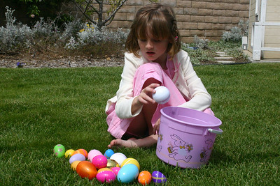 Sydney checking to see how many eggs she found after her Easter egg hunt.