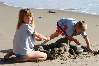 Christopher and Sydney having fun building a sand and rock fort at El Capitan State Beach.