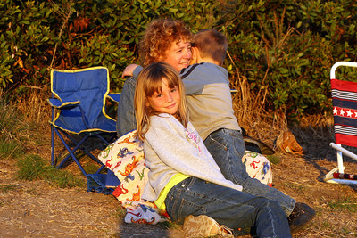 Kathy, Sydney and Christopher are watching for dolphins and getting ready for the sunset at El Capitan State Beach.
