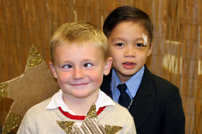 Christopher and Eli after the First Baptist Day School 2005 Christmas Program. Yes, Christopher has found another way to put his unique mark on pictures. The bandage on Eli's head? That's courtesy of a golf club and Sydney!