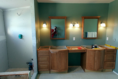 The new vanities--MasterBath brand from Home Depot--have been installed in the master bath. Still a lot of work to do, but Kathy is happy to finally see some progress.