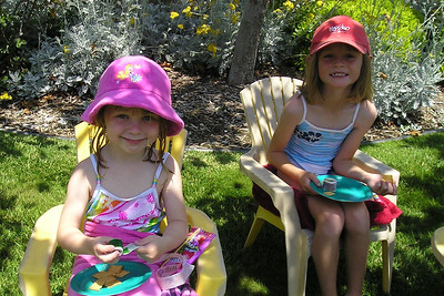 Sydney and Annabelle are enjoying the kiddie pool in our back yard.