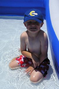 Christopher enjoying the kiddie pool in our backyard.