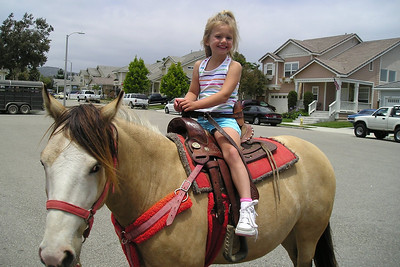 Brooke having a great time on the pony ride at her birthday party.