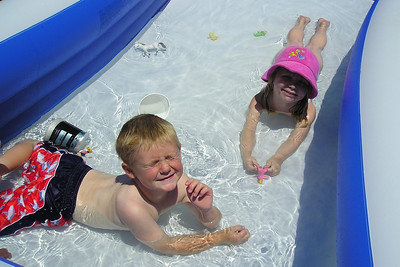 Christopher and Annabelle are enjoying the kiddie pool in our backyard.