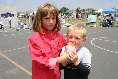 Sydney and Christopher sharing a snowcone at the Rio Del Norte Festival.