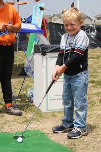 Christopher sunk a putt to win a goldfish at the Rio Del Norte Festival.