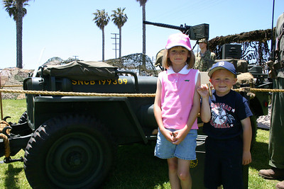 Sydney & Christopher standing next to a World War II vintage jeep during Seabee Days.