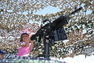 Sydney manning a HMMWV-mounted machine gun at Seabee Days.