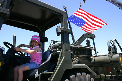 Sydney at the wheel of a piece of construction equipment (a scraper?) at Seabee Days.