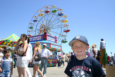 Christopher is enjoying the carnival rides during Seabee Days.