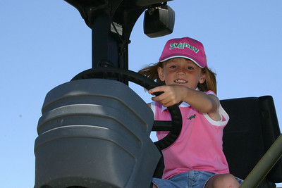 Sydney at the wheel of a roller-compactor during Seabee Days