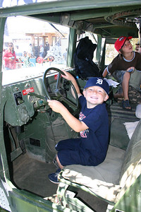 Christopher at the wheel of a HMMWV during Seabee Days.