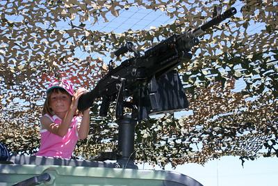 Sydney manning a HMMWV-mounted machine gun at Seabee Days