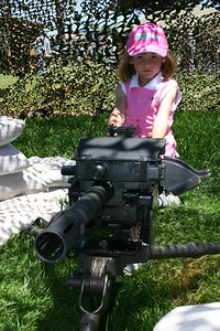 Sydney ready to shoot a crew-served weapon during Seabee Days