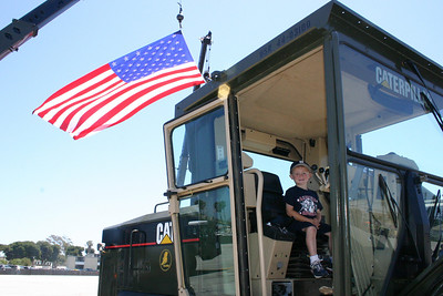 Christopher at the wheel of a grader during Seabee Days.