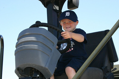 Christopher at the wheel of a roller-compactor during Seabee Days