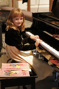 Sydney warming up for her piano recital.