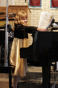 Sydney playing Christmas Parade, Melody and Chords and Jingle Bells for her frist piano recital.