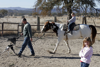 Uncle Frank leading Joker around the corral (with a little help from Kanga) before Christopher's riding lessons during our Thanksgiving visit with Aunt Betsy and Uncle Frank.