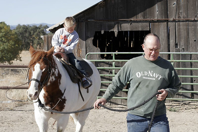 Uncle Frank leading Joker around the corral before Christopher's riding lessons during our Thanksgiving visit with Aunt Betsy and Uncle Frank.