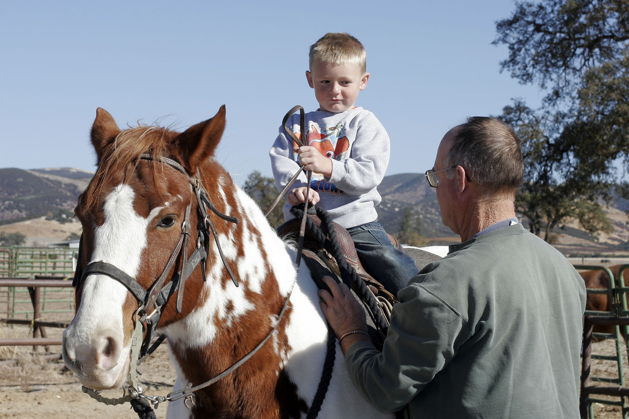 Uncle Frank handing the reins to Christopher for his riding lesson during our Thanksgiving visit with Aunt Betsy and Uncle Frank.