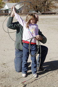 Uncle Frank giving Sydney lessons on how to rope a steer.