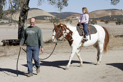 Uncle Frank leading Joker around the barn before Sydney's riding lessons during our Thanksgiving visit with Aunt Betsy and Uncle Frank.