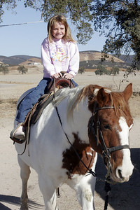 Sydney riding a horse (Joker) during our Thanksgiving visit with Aunt Betsy and Uncle Frank.